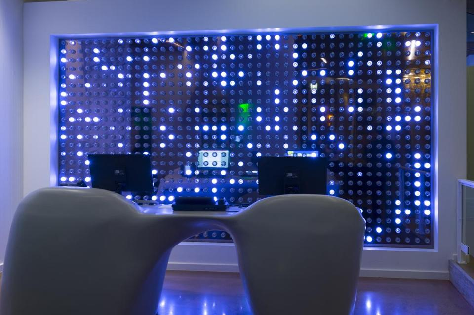 A lighted wall at the hotel's front desk.